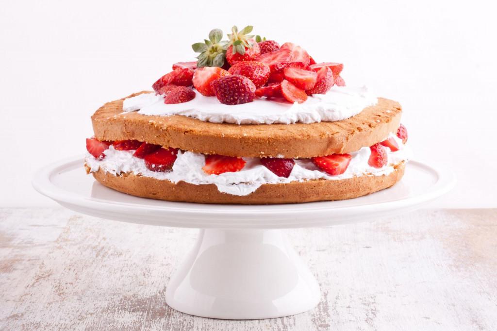 strawberry cream cake on a white background