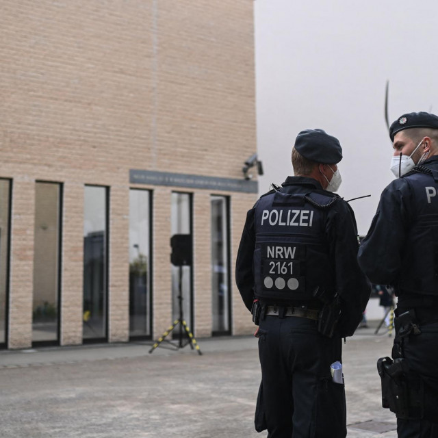 """Policemen stand in front of the synagogue during a vigil of the Initiative against Anti-Semitism Gelsenkirchen in Gelsenkirchen, western Germany, on May 14, 2021. - Germany vowed """"unwavering"""" protection of its synagogues after scattered demonstrations over the escalating conflict in the Middle East saw protesters shout anti-Israeli slogans and burn Israeli flags, and around 180 people shouted anti-Israeli slogans at a march in Gelsenkirchen in the evening of May 12, 2021. (Photo by Ina FASSBENDER/AFP)"""