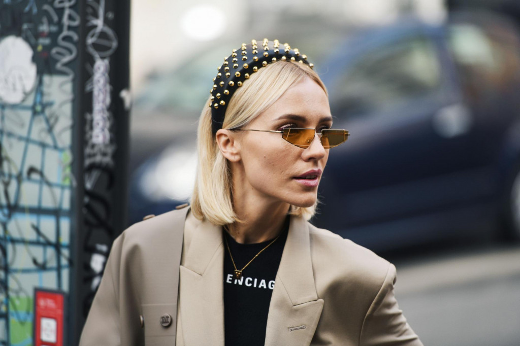 Milan, Italy - February 21, 2019: Street style – Woman wearing Balenciaga after a fashion show during Milan Fashion Week - MFWFW19