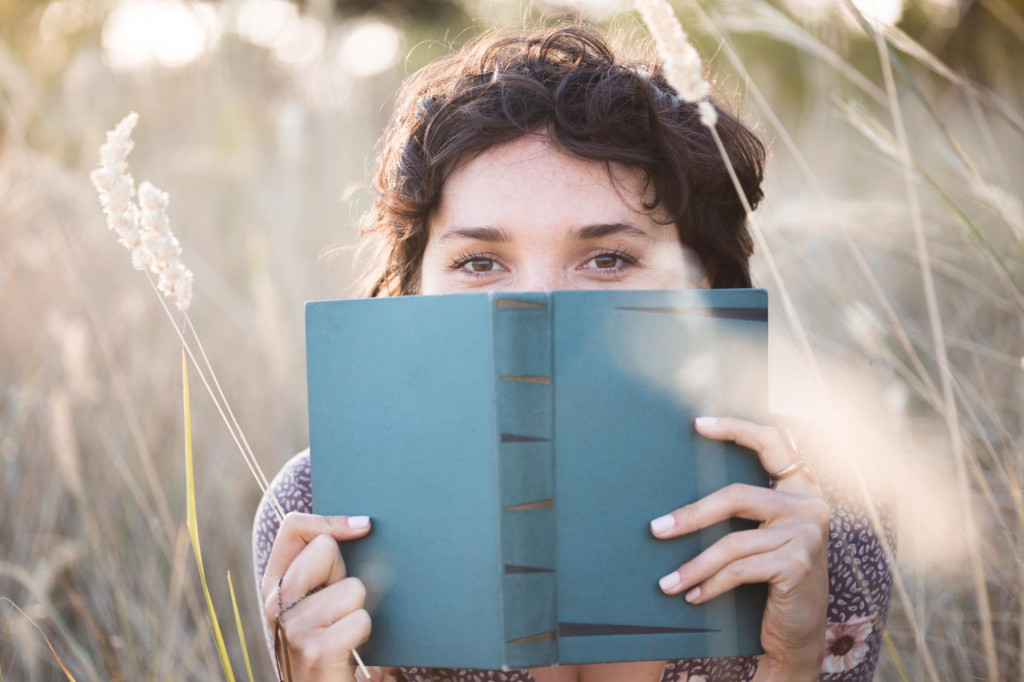 retro style. girl reads a book outdoors