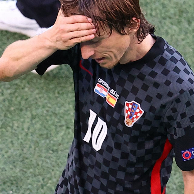 Croatia's midfielder Luka Modric gestures as he walks off the pitch during the UEFA EURO 2020 round of 16 football match between Croatia and Spain at the Parken Stadium in Copenhagen on June 28, 2021. (Photo by WOLFGANG RATTAY/POOL/AFP)