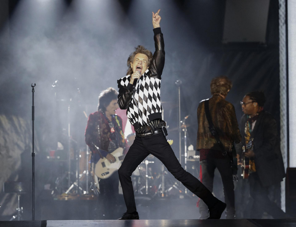 """Mick Jagger (C), Charlie Watts (partially hidden) and Keith Richards of the Rolling Stones perform as they resume their """"No Filter Tour"""" North American Tour at the Soldier Field on June 21, 2019 in Chicago. (Photo by Kamil Krzaczynski/AFP)"""