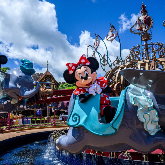 Cast members dressed as cartoon characters Minnie Mouse (R) and Mickey Mouse (L) sit on a ride as part of a publicity exercise for the media at Hong Kong's Disneyland on June 17, 2020, a day before the theme park's doors reopen following nearly five months of closure in a fresh boost for a city that has largely managed to defeat the COVID-19 coronavirus. - It is just the second Disneyland around the world to resume services during the pandemic after Shanghai turned its lights and rides back on last month. (Photo by Anthony WALLACE/AFP)