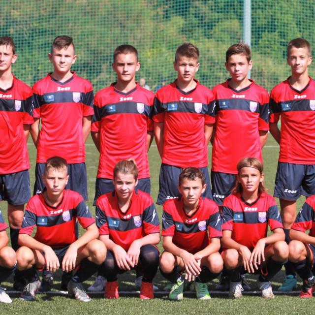 Pioniri (U14) Župe dubrovačke s trenerom Mariom Bartulovićem