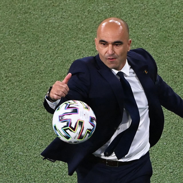 Belgium's Spanish coach Roberto Martinez goes for the ball on the touchline during the UEFA EURO 2020 quarter-final football match between Belgium and Italy at the Allianz Arena in Munich on July 2, 2021. (Photo by STUART FRANKLIN/POOL/AFP)
