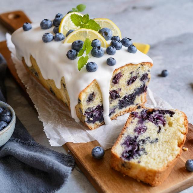 Fresh lemon blueberry loaf of bread cake with sugar glaze